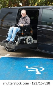 Disabled man on wheelchair car lift