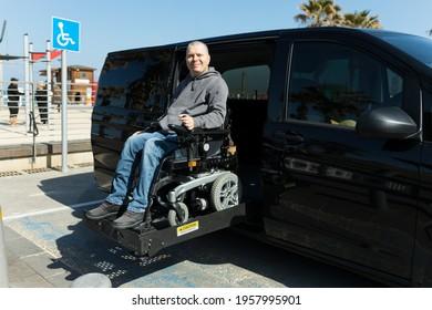 Disabled man on wheelchair car lift