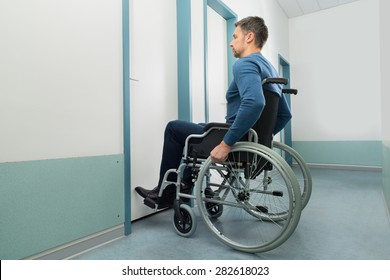 Disabled Man On Wheelchair Entering In Room