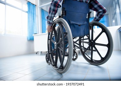 A disabled man on a wheelchair in the office Young man with disabilities in Asia. A man on a wheelchair Recovery and health care ideas Teamwork in Office