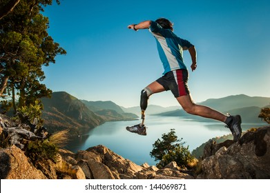 Disabled man with prosthetic leg, jumping in Patagonia.