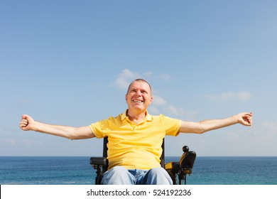 Disabled man sitting in wheelchair showing freedom.
