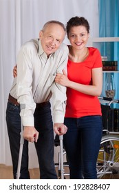 Disabled man standing with his nurse, vertical