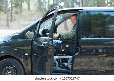 Disabled man in wheelchair drive a car