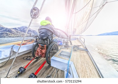 disabled man with wheelchair on sailing boat