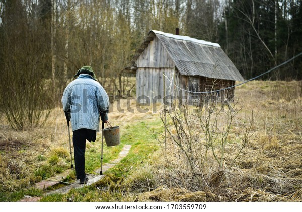 disabled-man-works-village-600w-17035597