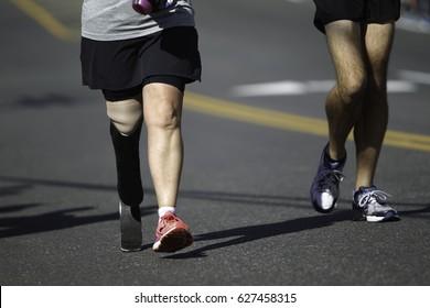A Disabled Marathon Runner running on the track.