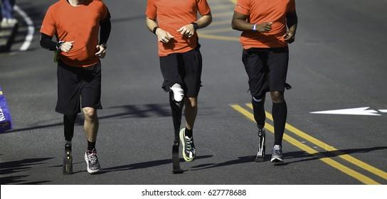 Disabled Marathon Runners running at Boston Marathon.