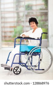 disabled middle aged woman sitting on wheelchair at home