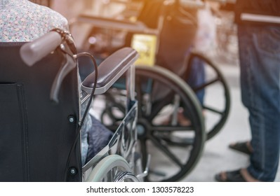 Disabled older man patient sitting wheelchair waiting services therapy  from Doctor in hospital clinic. Wheelchair is chair with wheels, used when walking difficult impossible to illness,  disability