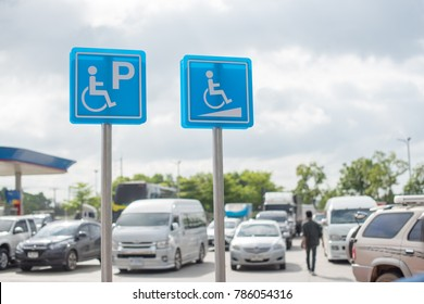 Disabled parking sign at gas station.