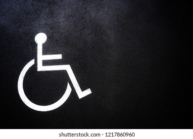 Disabled people icon or Handicap symbol on parking space.Sign design on urban asphalt road.Wheel chair logo on copy space empty blank.Disability Concept.