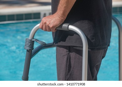 Disabled person is attempting to go swimming for physical therapy .using a walker for support .