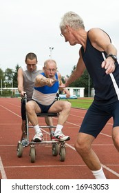 Disabled person and his helper reaching for an other athlete to pass him the baton. Caricature picture to illustrate helping, giving, disabilty, ability, getting older, not wanna quit.
