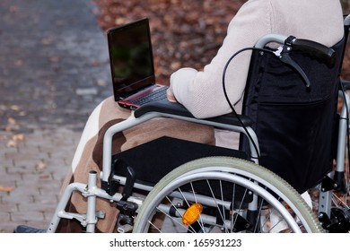 Disabled person using laptop and surfing the Internet