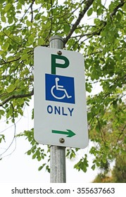 disabled persons parking sign with a background blur