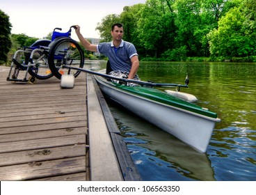 Disabled rower before beginning his training with his wheelchair on boardwalk