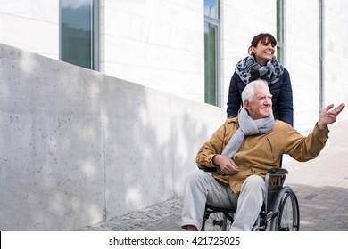 Disabled senior man enjoying a sunny autumn day