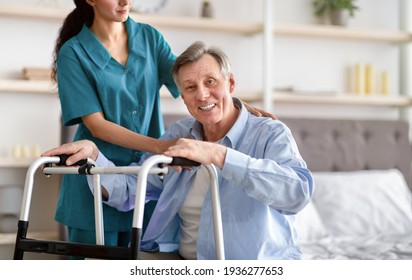 Disabled senior man receiving medical assistance from young caregiver at home, copy space