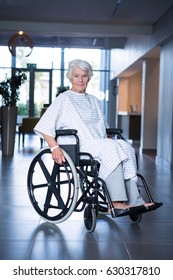 Disabled senior patient on wheelchair in hospital corridor at hospital