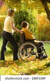 Disabled senior woman in a wheelchair