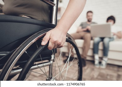Disabled Soldier In A Wheelchair. Disability Problem. After War Concept. Camouflage Uniform. Paralyzed Woman. Home Leisure. Return From Army. Hands On Wheels. Family Background. Husband And Son.
