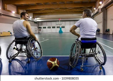 disabled sport men relaxation while playing indoor basketball at a basketball court