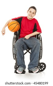 Disabled teen boy enjoys playing basketball.  Full body isolated on white.