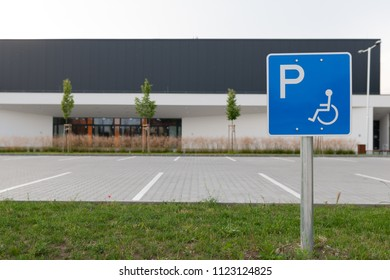 Disabled traffic sign at an empty car park represent handicap parking space without car or people