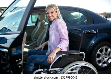 Disabled woman making a safe approach to her automobile on the parking space for physically challenged people