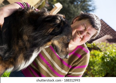 disabled woman sitting outdoors with an half breed dog