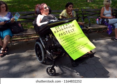 Disabled Woman in Wheelchair With Anti Brett Kavanaugh Sign at Protest Against Trump's Supreme Court Nominee In Foley Square, New York, NY, USA - August 26, 2018