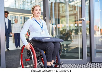 Disabled woman in a wheelchair in front of the office for inclusion and after work concept