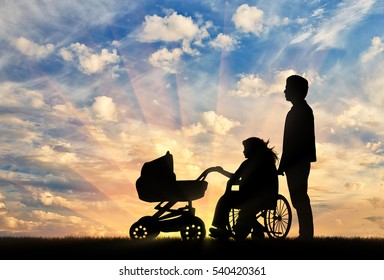 Disabled woman in wheelchair holding pram with her husband against sky. Concept disabled and family