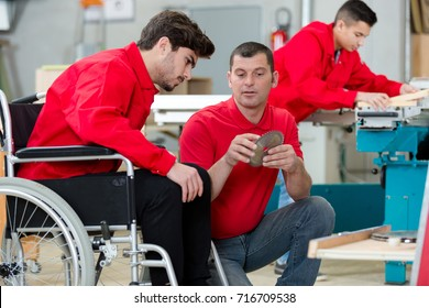 disabled worker in wheelchair in a carpenters workshop