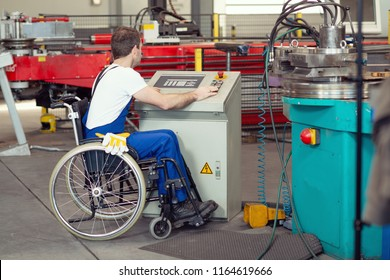 disabled worker in wheelchair in factory on the machine