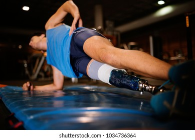 Disabled young man training in the gym. Disabled sportsman Concept.