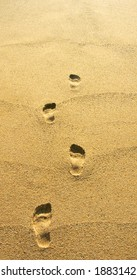 Disappearing footprints in the sand