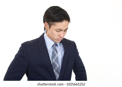 Disappointed Asian businessman.