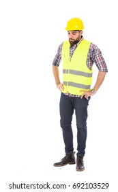 Disappointed beard engineer wearing caro shirt and jeans with yellow vest and helmet, isolated on white background