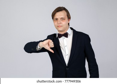 Disappointed business man with thumb down