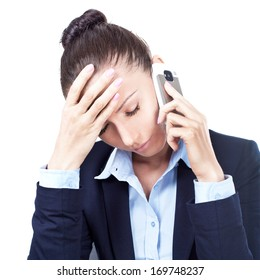 Disappointed business woman talking on the phone in office