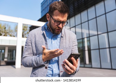 Disappointed businessman with a phone