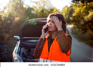 Disappointed female driver calling car assistance
