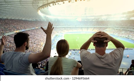 Disappointed football fans unsatisfied with referee decision, emotional game