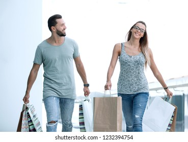 disappointed husband and wife with shopping.