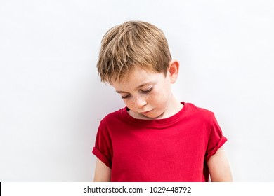 disappointed little child looking down expressing solitude, disillusion, sadness or education and parent problems, white background