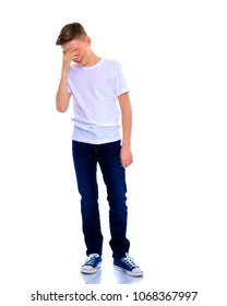 Disappointed little school-age boy. The concept of childhood, emotions. Isolated on white background.