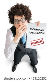 Disappointed man is showing document with rejected mortgage application. Isolated on white background.