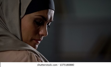Disappointed muslim woman sighs sadly, cultural limitations, hopelessness crisis